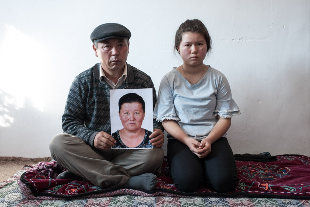 Muralu Tusypjuly and his 13-year-old daughter have been missing their wife and mother since November 2018, who is being held captive in a re-education camp in Xinjiang. The Russian photographer Konstantin Salomatin travelled to Almaty in November 2018 for the following portrait series. / Photo: Konstantin Salomatin, n-ost